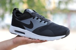 hot sales 25c46 9d898 Nike Tavas Running Shoes for Men