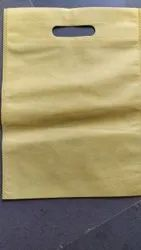 Handled Yellow D Cut Non Woven Bag, Capacity: 2 Kg