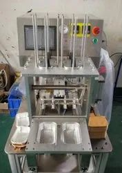 FULLY AUTOMATIC FOIL CONTAINER SEALING MACHINE