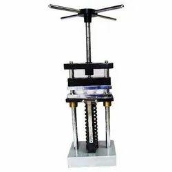 Compression Set Apparatus At Strain