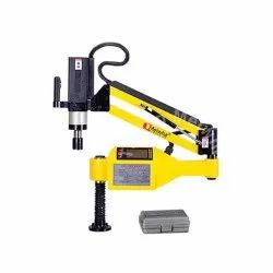 Yellow Tapping Machine