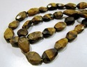 Natural Tiger Eye Oval Faceted Beads