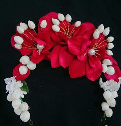 Artificial red flowers hair bun