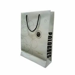 Printed Rope Handle Art Paper Carry Bag, For Shopping, Capacity: 1.5 Kg