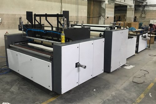 Manufacturer of Automatic Paper Napkin Machine & Toilet
