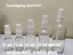 Clear glass bottle with spray