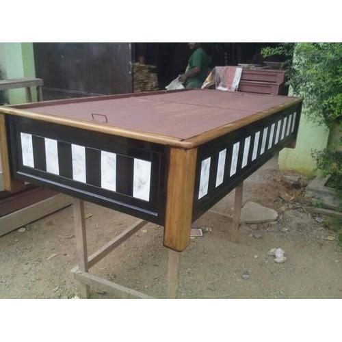 plain wooden diwan with storage table