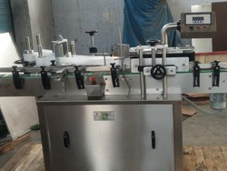 AUTOMATIC ROUND BOTTLE LABELING MACHINE.