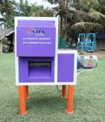 AUTOMATIC COCONUT SKIN PEELING MACHINE
