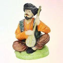 Man Sitar Statue