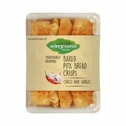 Wingreens Farms Baked Chilli Garlic Pita Bread Crisps, For Bakery, Packaging Size: 250 Gm