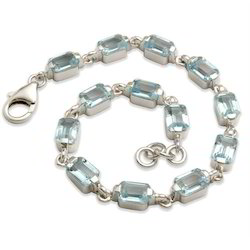 Women Bracelet In Silver And Blue Topaz