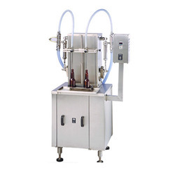 Volumetric Bottle Filling Machine, Output: 50-60 Container/ Min