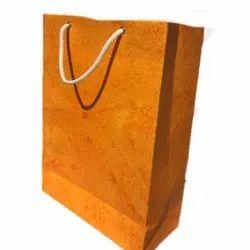 Orange Designer Paper Bag, For Shopping, Capacity: 2-5kg