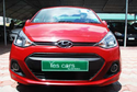 Maroon Hyundai Xcent Car
