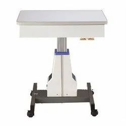 Motorised table with drawer systems
