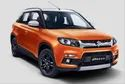 Orange And Grey Deisel Maruti Suzuki Vitara Brezza Car