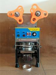 Glass, Juice Filling and Sealing Machine