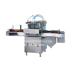Semi Automatic Liquid Filling and Capping Machine