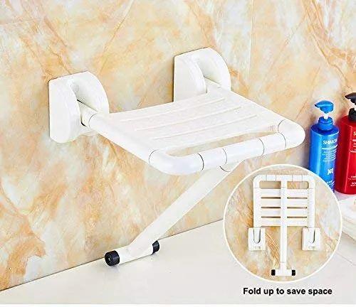 Plastic folding shower seat