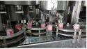 Automatic Glass Bottle Filling Machine, Machine Capacity : 10-100 Bottles/min